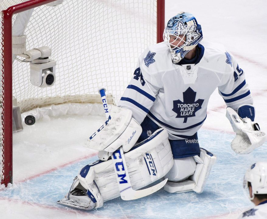 Toronto Maple Leafs goaltender Jonathan Bernier is scored on by Montreal Canadiens' Alex Galchenyuk during the first period of an NHL hockey game in Montreal, Saturday, March 1, 2014. (AP Photo/The Canadian Press, Graham Hughes)