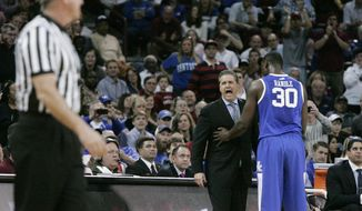 Kentucky coach John Calipari reacts as he is called for a technical foul during the first half of an NCAA college basketball game against South Carolina on Saturday, March 1, 2014, in Columbia, S.C. Calipari was ejected in the second half as South Carolina defeated Kentucky 72-67. (AP Photo/Mary Ann Chastain)