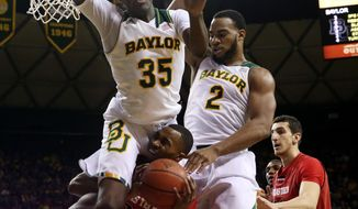 Baylor's Taurean Prince (35) and Rico Gathers (2) jumps over Texas Tech  forward Jaye Crockett (30) during the first half of an NCAA college basketball game, Saturday, March, 1, 2014, in Waco, Texas. (AP Photo/Waco Tribune Herald, Michael Bancale)