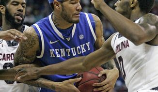 Kentucky's  Willie Cauley-Stein (15) battles for the rebound with South Carolina's  Sindarous Thornwell (0),and Desmond Ringer during the first half of an NCAA college basketball game Saturday March 1, 2014 in Columbia, S.C. (AP Photo/Mary Ann Chastain)