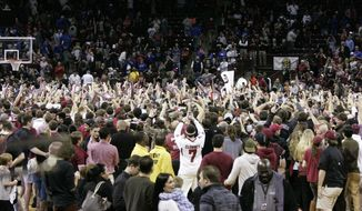South Carolina's fans storm the court after South Carolina defeated No. 17 Kentucky 72-67 in an NCAA college basketball game Saturday, March 1, 2014, in Columbia, S.C. (AP Photo/Mary Ann Chastain)