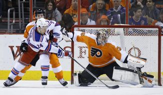 Philadelphia Flyers' Steve Mason, right, blocks a shot by New York Rangers' Ryan Callahan during the second period of an NHL hockey game, Saturday, March 1, 2014, in Philadelphia. (AP Photo/Matt Slocum)