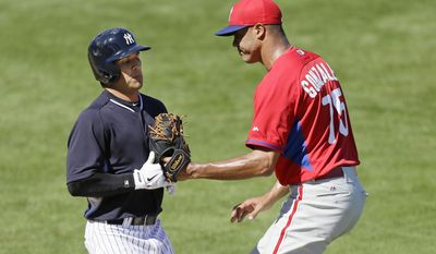 New York Yankees second baseman Brian Roberts, left, is tagged out by Philadelphia Phillies pitcher Miguel Alfredo Gonzalez during the third inning of an exhibition baseball game Saturday, March 1, 2014, in Tampa, Fla. (AP Photo/Charlie Neibergall)