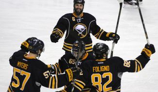 Buffalo Sabres' Tyler Myers (57) Brian Flynn (65), Mike Weber (6) and Marcus Foligno (82) celebrate a goal by Flynn during the third period of an NHL hockey game against the San Jose Sharks in Buffalo, N.Y., Friday, Feb. 28,  2014. Buffalo won 4-2. (AP Photo/Gary Wiepert)