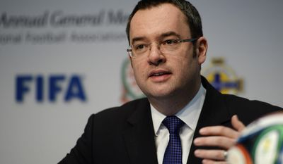 Alex Horne, CEO of The Football Association, speaks during a press conference following the 128 Annual General Meeting of the International Football Association Board IFAB, on Saturday, March 1, 2014, in Zurich, Switzerland. (AP Photo/Keystone,Steffen Schmidt)