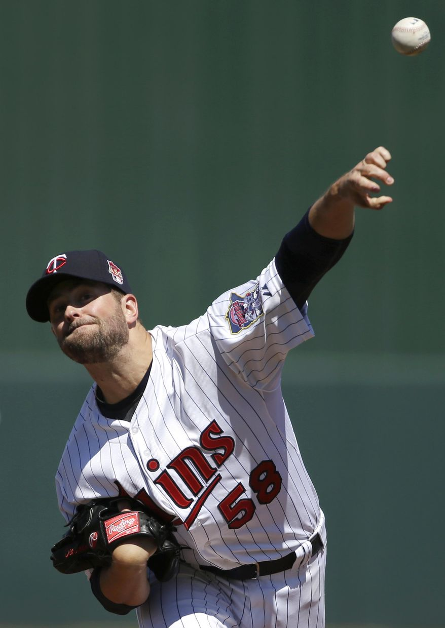 Minnesota Twins pitcher Scott Diamond delivers a warm-up throw in the first inning of an exhibition baseball game against the Boston Red Sox, Saturday, March 1, 2014, in Fort Myers, Fla. (AP Photo/Steven Senne)