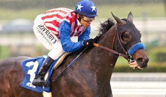 In a photo provided by Benoit Photo, Kaleem Shah's Awesome Baby and jockey Mike Smith win the Grade III $100,000 Santa Ysabel Stakes horse race, Saturday, March 1, 2014, at Santa Anita Park in Arcadia, Calif. (AP Photo/Benoit Photo)