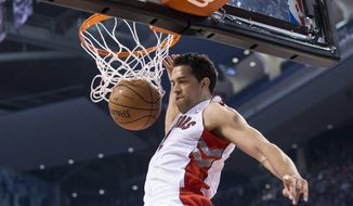 Toronto Raptors' Landry Fields scores against the Golden State Warriors during the first half of an NBA basketball game Sunday, March 2, 2014, in Toronto. (AP Photo/The Canadian Press, Chris Young)