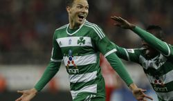 Panathinaikos' Marcus Berg of Sweden celebrates after scoring the second goal of his team against Olympiakos during a Greek League soccer match at Georgios Karaiskakis stadium, in Piraeus port, near Athens, on Sunday, March 2, 2014. (AP Photo/Thanassis Stavrakis)