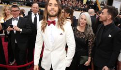Jared Leto, center, arrives with his mother Constance and brother Shannon at the Oscars on Sunday, March 2, 2014, at the Dolby Theatre in Los Angeles.  (Photo by Matt Sayles/Invision/AP)