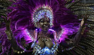 A dancer from the Nene de Vila Matilde samba school performs during a carnival parade in Sao Paulo, Brazil, Sunday, March 2, 2014. (AP Photo/Andre Penner)