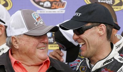 Kevin Harvick, right, laughs with former driver A.J. Foyt in Victory Lane after Harvick own the NASCAR Sprint Cup Series auto race on Sunday, March 2, 2014, in Avondale, Ariz. (AP Photo/Ross D. Franklin)