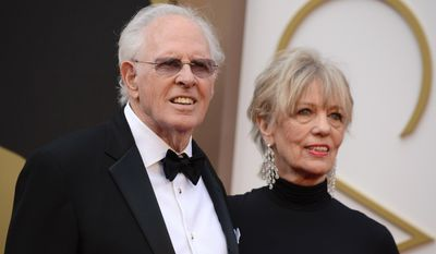 Bruce Dern, left, and Andrea Beckett arrive at the Oscars on Sunday, March 2, 2014, at the Dolby Theatre in Los Angeles.  (Photo by Jordan Strauss/Invision/AP)