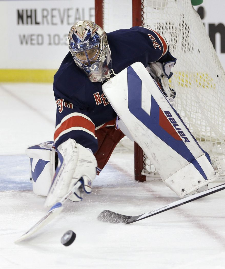 New York Rangers goalie Henrik Lundqvist makes a save during the first period of the NHL hockey game against the Boston Bruins Sunday, March 2, 2014, in New York. (AP Photo/Seth Wenig)