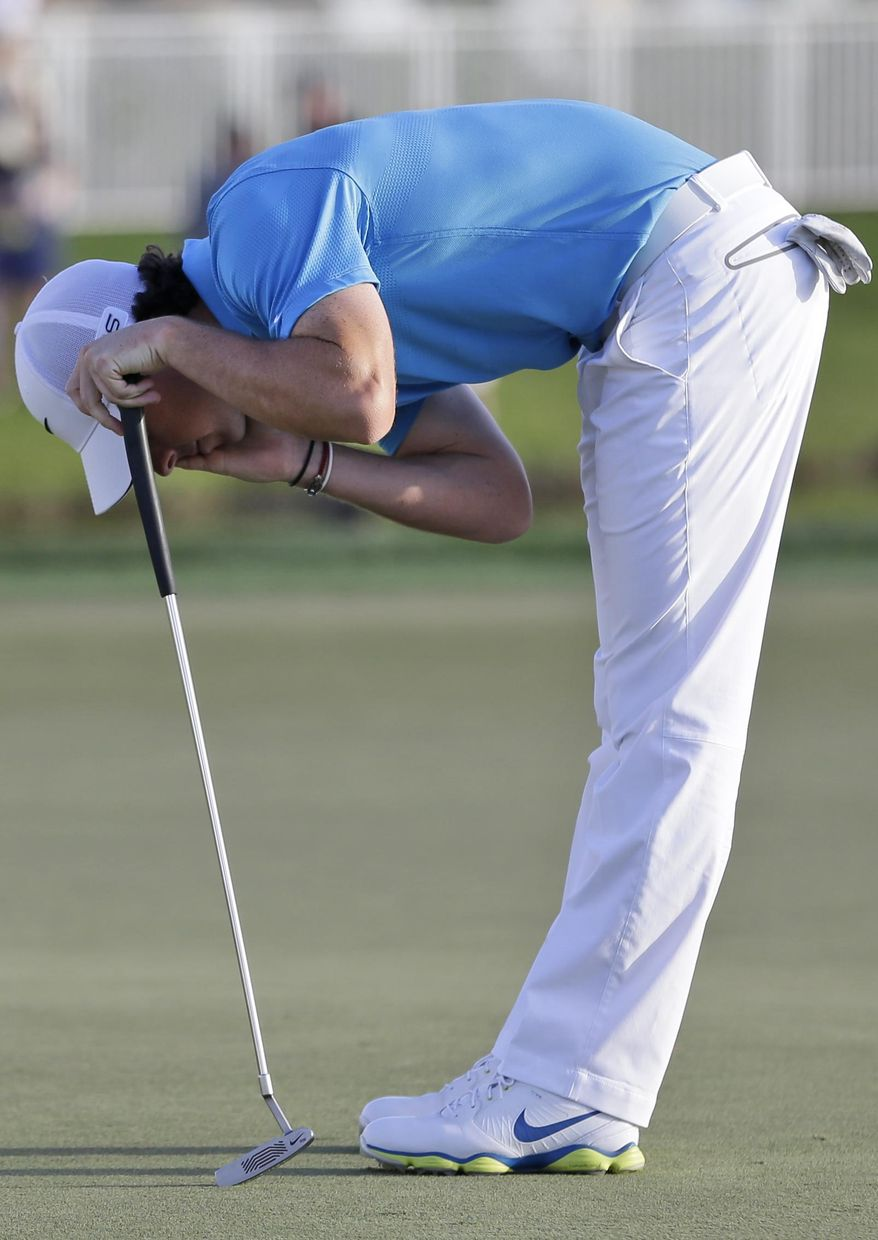 Rory McIlroy, of Northern Ireland, reacts after missing a putt on the 16th hole during the final round of the Honda Classic golf tournament, Sunday, March 2, 2014 in Palm Beach Gardens, Fla. (AP Photo/Wilfredo Lee)