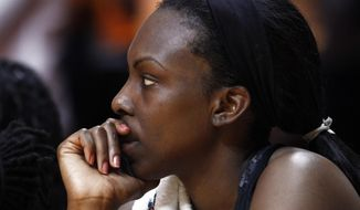 South Carolina center Elem Ibiam watches in the final seconds of an NCAA college basketball game against Tennessee, Sunday, March 2, 2014, in Knoxville, Tenn. Tennessee won 73-61. (AP Photo/Wade Payne)
