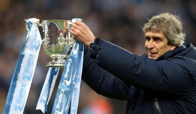 Manchester City's manager Manuel Pellegrini holds the League Cup Trophy after their English League Cup final soccer match against Sunderland at Wembley Stadium, London, England, Sunday, March 2, 2014. (AP Photo/Scott Heppell)