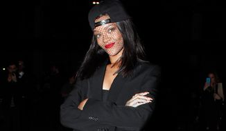 Singer Rihanna arrives at Givenchy's ready-to-wear fall/winter 2014-2015 fashion collection presented in Paris, Sunday, March 2, 2014. (AP Photo/Thibault Camus)