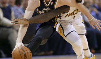 Indiana Pacers guard Lance Stephenson, right, fouls Utah Jazz guard Gordon Hayward as they go for a loose ball during the first half of an NBA basketball game in Indianapolis, Sunday, March 2, 2014. (AP Photo/Michael Conroy)