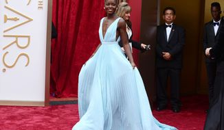 Lupita Nyong'o arrives at the Oscars on Sunday, March 2, 2014, at the Dolby Theatre in Los Angeles.  (Photo by Jordan Strauss/Invision/AP)