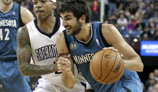 Minnesota Timberwolves guard Ricky Rubio, of Spain, right, drives to the basket past Sacramento Kings guard Isaiah Thomas during the first quarter of an NBA basketball game in Sacramento, Calif., Saturday, March 1, 2014.(AP Photo/Rich Pedroncelli)