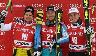 Norway's Kjetil Jansrud, center, winner of an alpine ski, men's World Cup super-g, poses for photographers on the podium with second-placed Switzerland's Patrick Kueng, left, and third-placed Austria's Matthias Mayer, in Kviitfjell, Norway, Sunday, March 2, 2014. (AP Photo/Alessandro Trovati)