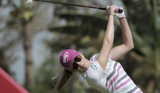 Paula Creamer of the U.S. tees off on the third hole as she plays in the final round of the HSBC Women's Champions golf tournament in Singapore, Sunday, Mar. 2, 2014. (AP Photo/Joseph Nair)
