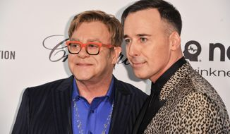 Elton John, left, and David Furnish arrive at the 2014 Elton John Oscar Viewing and After Party on Sunday, March 2, 2014, in West Hollywood, Calif. (Photo by Richard Shotwell/Invision/AP)