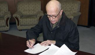 In this photo taken on Saturday, March 1, 2014, provided by the Korean Central News Agency, John Short, an Australian missionary detained for spreading Christianity in North Korea, signs his written apology, at an unknown location in North Korea.  North Korea said Monday, March 3, 2014, it will deport Short, saying he apologized for his anti-state religious acts and requested forgiveness. Authorities in North Korea have been investigating Short since his arrest for secretly spreading Bible tracts near a Buddhist temple in Pyongyang on Feb. 16, the birthday of late leader Kim Jong Il, the North's official Korean Central News Agency said. (AP Photo/Korean Central News Agency)