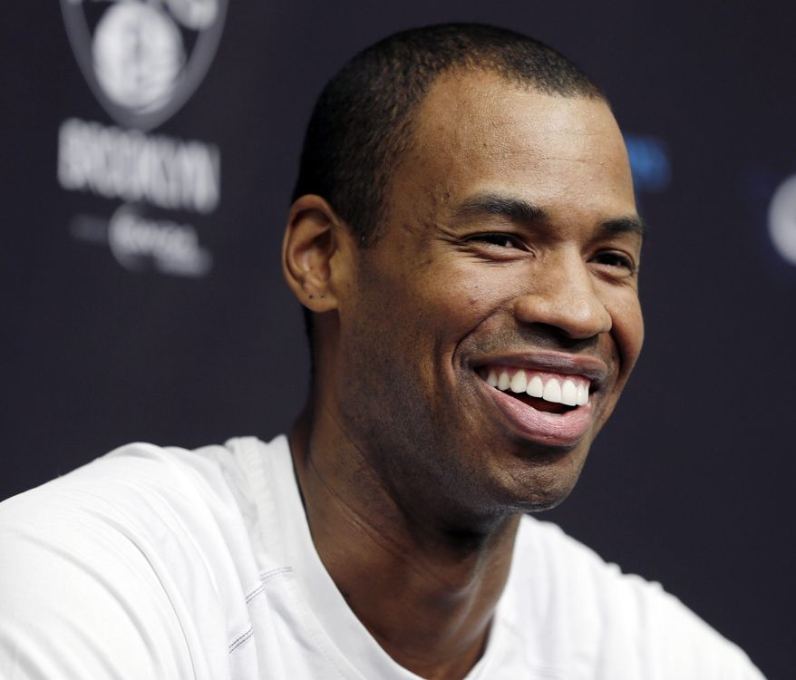 Brooklyn Nets Jason Collins speaks during a news conference before an NBA basketball game against the Chicago Bulls at the Barclays Center, Monday, March 3, 2014, in New York. More than a week after becoming the league's first openly gay player, Collins will finally get to play a home game Monday night. (AP Photo/Seth Wenig)