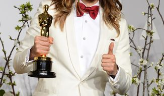 "Jared Leto poses in the press room with the award for best actor in a supporting role for ""Dallas Buyers Club"" during the Oscars at the Dolby Theatre on Sunday, March 2, 2014, in Los Angeles.  (Photo by Jordan Strauss/Invision/AP)"