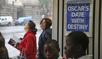 "People stand around a newspaper poster reading ""Oscar's date with destiny""  before Oscar Pistorius arrives at the high court in Pretoria, South Africa, Monday, March 3, 2014. Pistorius is charged with premeditated murder for the shooting death of his girlfriend, Reeva Steenkamp, on Valentine's Day in 2013. (AP Photo/Schalk van Zuydam)"