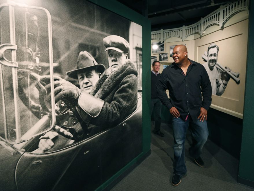 Former Chicago White Sox player Frank Thomas visits a Babe Ruth exhibition during his orientation visit at the Baseball Hall of Fame on Monday, March 3, 2014, in Cooperstown, N.Y. Thomas will be inducted to the hall in July. (AP Photo/Mike Groll)