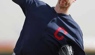FILE - In this Feb. 21, 2014 file photo, Cleveland Indians pitcher John Axford throws during spring training baseball practice in Goodyear, Ariz. After converting 49 consecutive saves from 2011 to early 2012, Axford has another streak going. The Indians closer went 18 for 18 on his Academy Awards picks.  (AP Photo/Paul Sancya, File)
