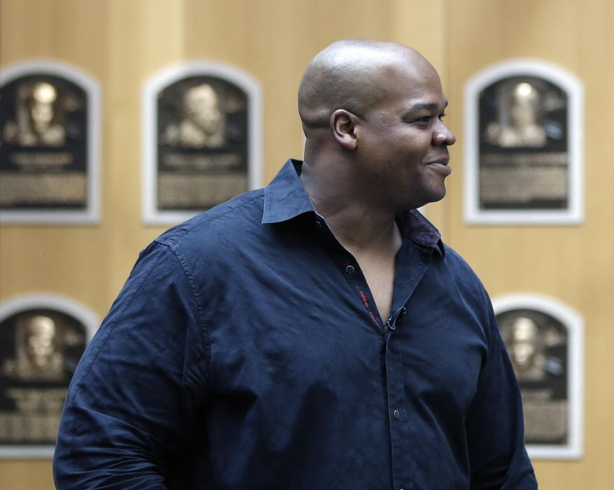 Former Chicago White Sox player Frank Thomas walks in the Plaque Gallery during his orientation visit at the Baseball Hall of Fame on Monday, March 3, 2014, in Cooperstown, N.Y. Thomas will be inducted to the hall in July. (AP Photo/Mike Groll)