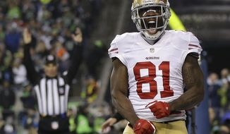 "FILE - In this Jan. 19, 2014 file photo, San Francisco 49ers' Anquan Boldin celebrates his touchdown catch during the second half of the NFL football NFC Championship game against the Seattle Seahawks, in Seattle. Boldin says he will be back with the San Francisco 49ers next season. Boldin wrote on his Twitter page Monday, March 3, 2014,  that he's ""returning to San Francisco. A spokesman for the 49ers said the team had no immediate comment. (AP Photo/Marcio Jose Sanchez, File)"