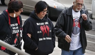 Katie Barnhart-Leon, center, the widow of slain Denver computer technician and pizza deliveryman Nathan Leon, walks with her mother Bernadette Alness, left, and father Marty Alness, as they arrive for a sentencing hearing for a woman who pleaded guilty to buying the handgun used to kill Leon and the director of Colorado Prisons, at the Federal Courthouse, in Denver, Monday March 3, 2014. Stevie Marie Anne Vigil was sentenced to more than two years in prison and three years supervision for buying the handgun for Evan Ebel, a parolee and member of a white supremacist prison gang. (AP Photo/Brennan Linsley)