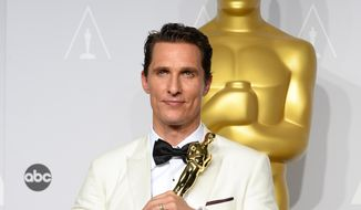 "Matthew McConaughey holds the award for best actor for his role in the ""Dallas Buyers Club"" in the press room during the Oscars at the Dolby Theatre on Sunday, March 2, 2014, in Los Angeles.  (Photo by Jordan Strauss/Invision/AP)"