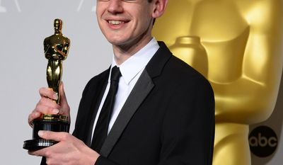 """Steven Price poses in the press room with the award for original score in a feature film for """"Gravity"""" during the Oscars at the Dolby Theatre on Sunday, March 2, 2014, in Los Angeles.  (Photo by Jordan Strauss/Invision/AP)"""