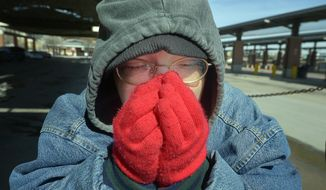 Dana Maxwell tries to keep warm at Intermodal Transportation Center in Fort Worth, Texas, Monday, March 3, 2014.  The couple said that they are homeless and had to leave the Presbyterian Night Shelter at 7 a.m. and plan to ride the bus all day to keep warm.  The National Weather Service issued a wind chill advisory until midmorning Monday for the Dallas-Fort Worth area. Forecasters say sunny conditions should return by Tuesday with highs in the upper 40s. (AP Photo/The Fort Worth Star-Telegram, Max Faulkner)  MAGS OUT; (FORT WORTH WEEKLY, 360 WEST); INTERNET OUT