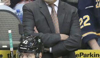 Dallas Stars head coach Lindy Ruff yells from the bench behind right wing Valeri Nichushkin (43) during the third period of an NHL hockey game against the Buffalo Sabres Monday, March 3, 2014, in Dallas. The Stars won 3-2. (AP Photo/LM Otero)