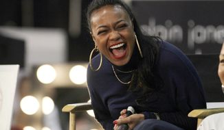 Actress Tatyana Ali laughs during the TGI Forum at the CIAA 2014 Basketball Tournament, on Saturday, March 1, 2014, in Charlotte, N.C. (Photo by Donald Traill/Invision /AP Images)