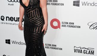 Britney Spears arrives at 2014 Elton John Oscar Viewing and After Party on Sunday, March 2, 2014 in West Hollywood, Calif. (Photo by Richard Shotwell/Invision/AP)