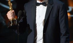 """Spike Jonze accepts the award for the best original screenplay of the year for """"Her""""during the Oscars at the Dolby Theatre on Sunday, March 2, 2014, in Los Angeles.  (Photo by John Shearer/Invision/AP)"""