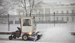 The sidewalk in front of the White House in Washington is cleared of snow, Monday, March 3, 2014. The National Weather Service has issued a Winter Storm Warning for the greater Washington Metropolitan region, prompting area schools and the federal government to close for the wintry weather. (AP Photo/Pablo Martinez Monsivais)