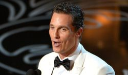 """Matthew McConaughey accepts the award for best actor in a leading role for """"Dallas Buyers Club"""" during the Oscars at the Dolby Theatre on Sunday, March 2, 2014, in Los Angeles.  (Photo by John Shearer/Invision/AP)"""