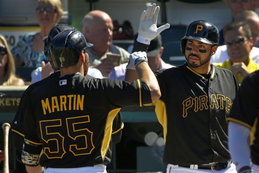 Pittsburgh Pirates' Russell Martin (55) is greeted by Pedro Alvarez after hitting a two-run home run off Boston Red Sox pitcher Brandon Workman during the third  inning of an exhibition spring training baseball game in Bradenton, Fla., Monday, March 3, 2014. The Pirates won 7-6. (AP Photo/Gene J. Puskar)