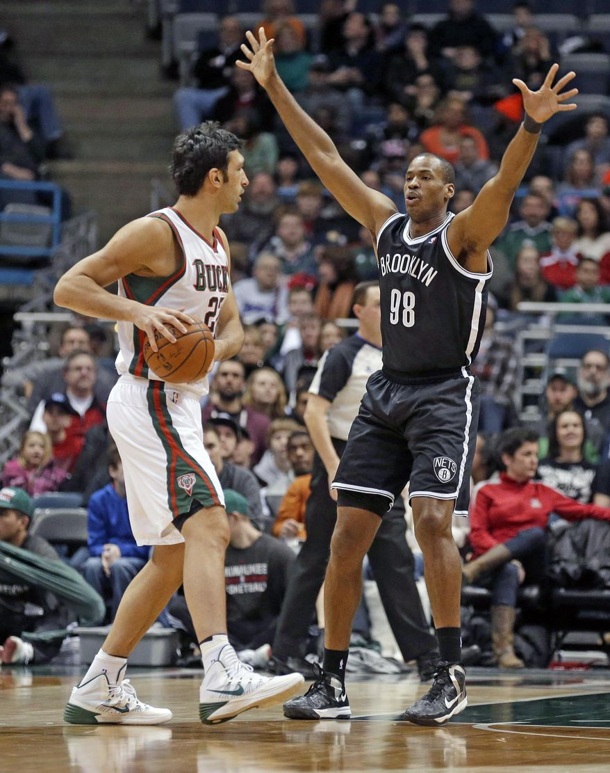 Brooklyn Nets' Jason Collins (98) defends against Milwaukee Bucks' ZaZa Pachulia, left, in the first half of an NBA basketball game, Saturday, March 1, 2014, in Milwaukee. (AP Photo/Jeffrey Phelps)