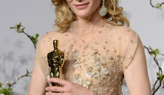 "Cate Blanchett poses in the press room with the award for best actress in a leading role for ""Blue Jasmine"" during the Oscars at the Dolby Theatre on Sunday, March 2, 2014, in Los Angeles.  (Photo by Jordan Strauss/Invision/AP)"