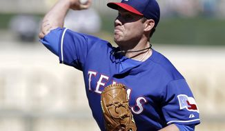 Texas Rangers pitcher Colby Lewis delivers to the Cleveland Indians during a spring training exhibition baseball game, Monday, March 3, 2014, in Surprise, Ariz. (AP Photo/Tony Gutierrez)